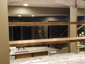 Arched mirror with mirror between shelves