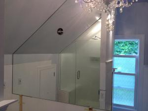 Custom fit mirror per pattern with outlet cutout and mirror plate