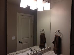 Mirror with holes for light fixture