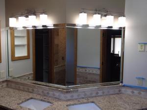 "Tight fit mirror w/ 2 "" Beveled Strips w/ 2"" x 2"" Square Corners"